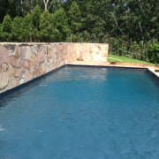 stone wall build with poured concrete