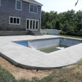 Stone patio created by Patricks Pools