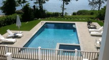 Pool, overflow spa, and bluestone patio on the bay