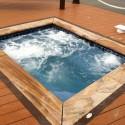 Gunite spa renovation blue marbledust, porcelain tile, and rainbow petrified wood stone coping on dune road westhampton patricks pools