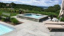Patio, pool renovation with spa addition overlooking Port Jeff Harbor