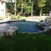 mountain lake swimming pool with waterfall