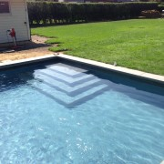 automatic pool cover with hidden leading edge